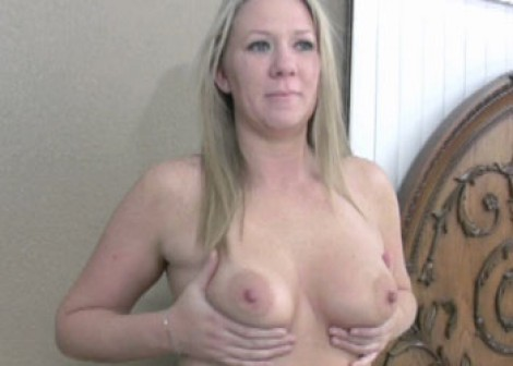 Curvy blonde Crystal plays with toys